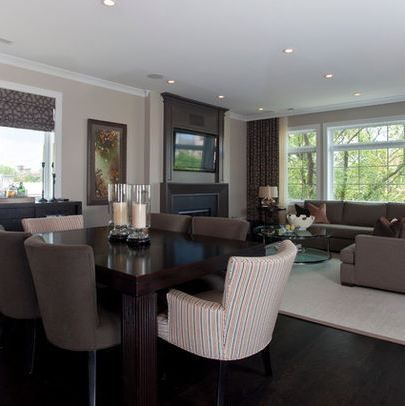 From the web, I don't remember which site. Living room dining room combo. I like how the couch is open up to the dining room, versus having its back to it.