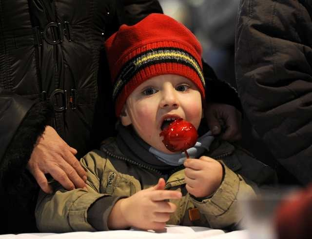 A boy eats a caramel-covered apple during a traditional gathering by a bonfire in Macedonia's capital Skopje, Thursday, Jan. 5, 2012, a night before Christian Orthodox Christmas Eve.     http://www.kansascity.com/2012/01/05/3355118/star-shots-best-photos-from-january.html#slide-31