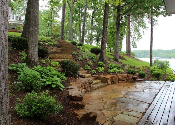 Simply beautiful low wall steps plants make a very nice for Landscaping ideas for wooded areas