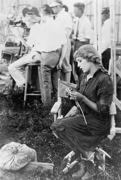 Mary Pickford knits a sweater for disabled World War I veterans while waiting for filming to begin on Sparrows in 1926