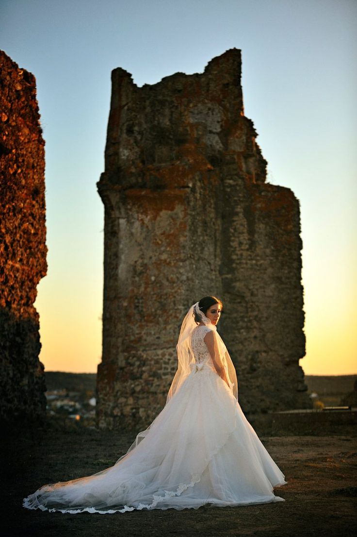 It was during a September golden light in the Castle ruins, on their Wedding day... From the Alentejo plains sunset, comes this photoshoot: when Wedding Photography and Landscape hold hands in a warm color, scenic and romantic shoot, at the ancient Castle in Alentejo, Portugal.  #fotodesonho #castlewedding  #sunset #warmcolors #wedding #weddingday #weddinginspiration #weddingstyle #weddingphotography  #fineartwedding #fineartphotographer #weddingphotographer #bridalstyle #fineartbride