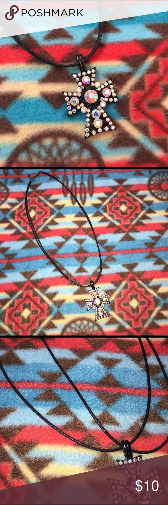 Black Rhinestone Cross Necklace Black Rhinestone Cross Necklace. Rhinestones have iridescent quality that throws various colors mainly pinks and blues. Very beautiful necklace in great condition wore a couple of times Jewelry Necklaces