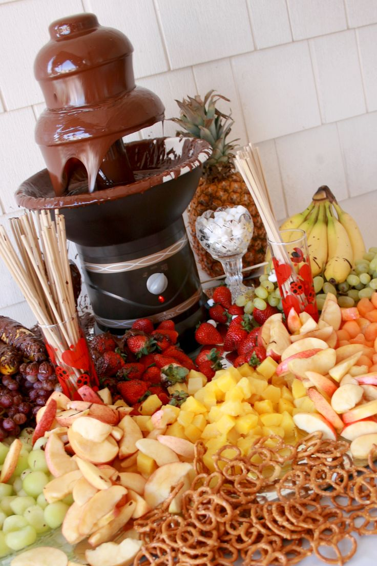 Chocolate Fountain w/Condiments Provided by Floral Expressions, by the sea.  A Chocolate Fountain is always a favorite at any party!