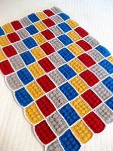 Lego Afghan (crochet).    personally, I would do some kind of border on this thing. Even another row of singles all around would do something to smooth it out, and then a row of slip stitches. Or if you wanted it a little weird you could do reverse single crochet for a border.
