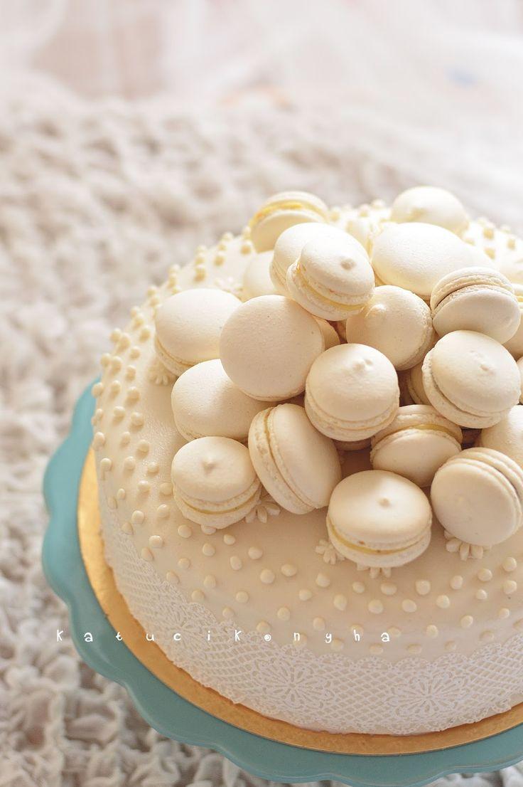 white wedding cake with macarons