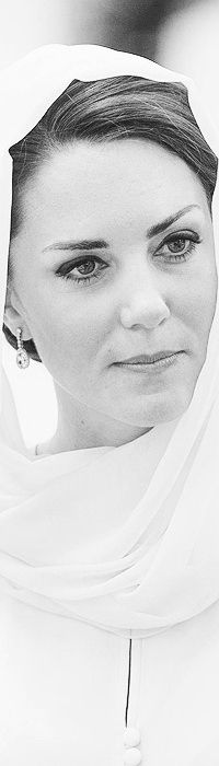Catherine Duchess of Cambridge Magnificently Beautiful With Her Hair and Head Covered In A White Headdress For Modesty.