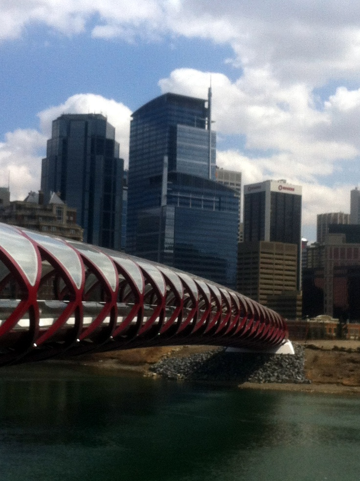 Calatrava-designed Peace Bridge over Bow River, with Calgary downtown office towers behind
