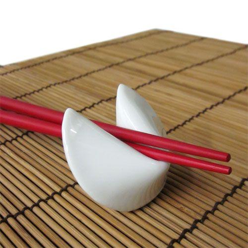 Fortune Cookie Chopstick Rests, Porcelain Fortune Cookie Chopstick Rest | Japanese Style, Inc.Link: http://www.japanesestyle.com/fortune-cookie-chopstick-rests-12-pack