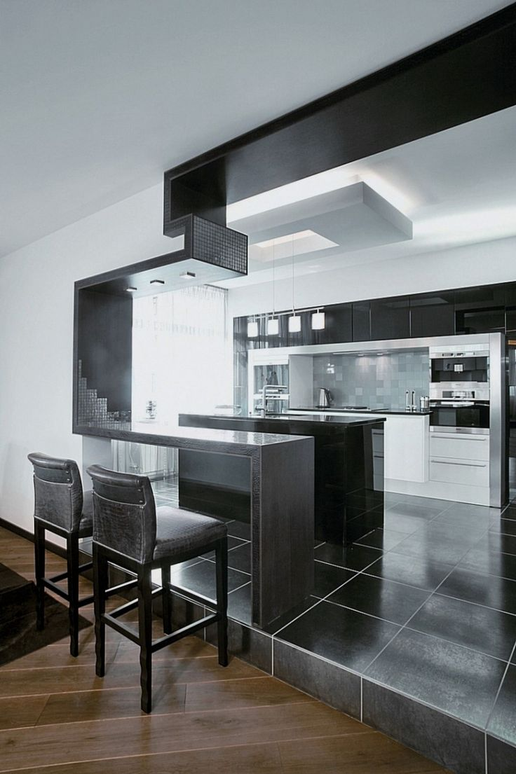 Great use of lines and shape in this contemporary kitchen. The bar looks like a puzzle piece cutout.  Virtuvė