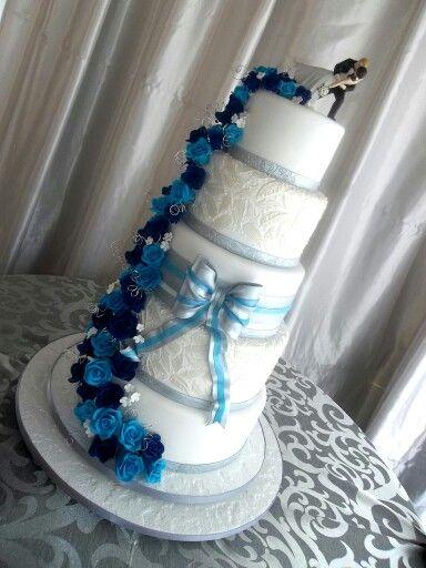 Blue and white 5 tier wedding cake. Ferrero Roche...cris.lanzetti@hotmail.com