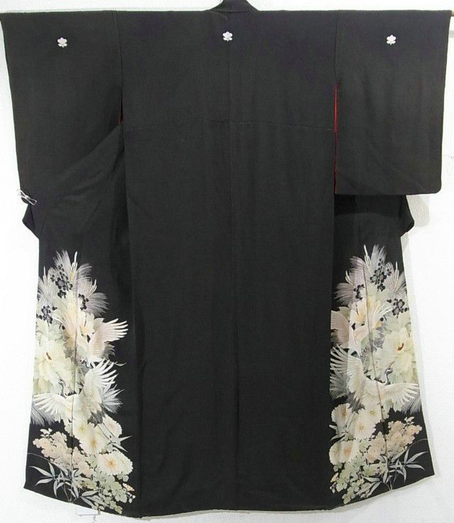 This is a vintage Kurotomesode kimono with flowers such as 'Botan'(peony), 'Kiku'(chrysanthemum) and flying cranes pattern, which is dyed.