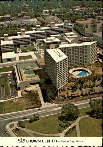 Kansas City MO Crown Center Hotel, Office Complex A superb 730-room hotel and a five-building office complex are two major features of Crown Center, Kansas City's $200 million downtown suburb. The Crown Center Hotel (foreground) with its guest