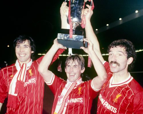 Alan Hansen, Kenny Dalglish and Graeme Souness celebrate winning the 1984 League Cup final against Everton