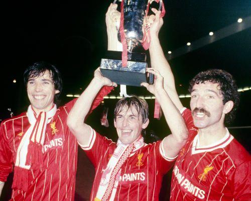 Alan Hansen, Kenny Dalglish and Graeme Souness celebrate winning the 1984 League Cup final against Everton