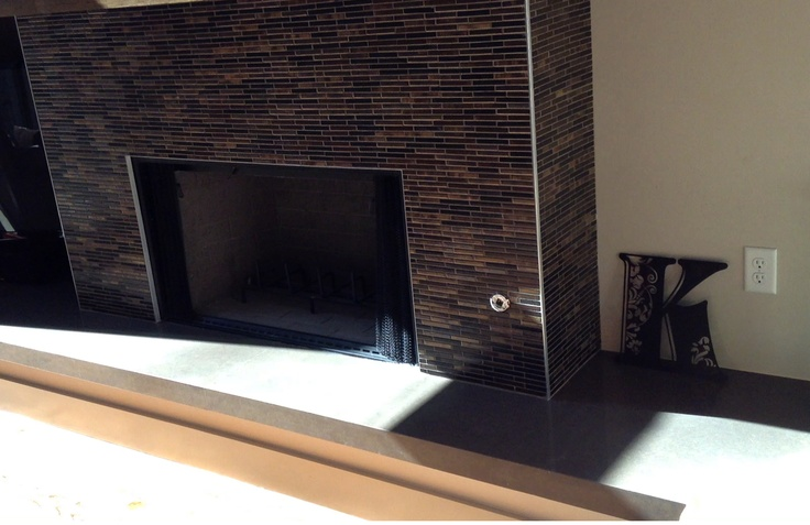 Caesarstone quartz fireplace hearth provided by texas for Engineered fireplace