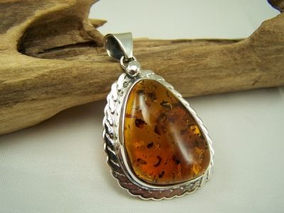 Fantastic big cognac amber pendant with ornamental sterling silver frame.