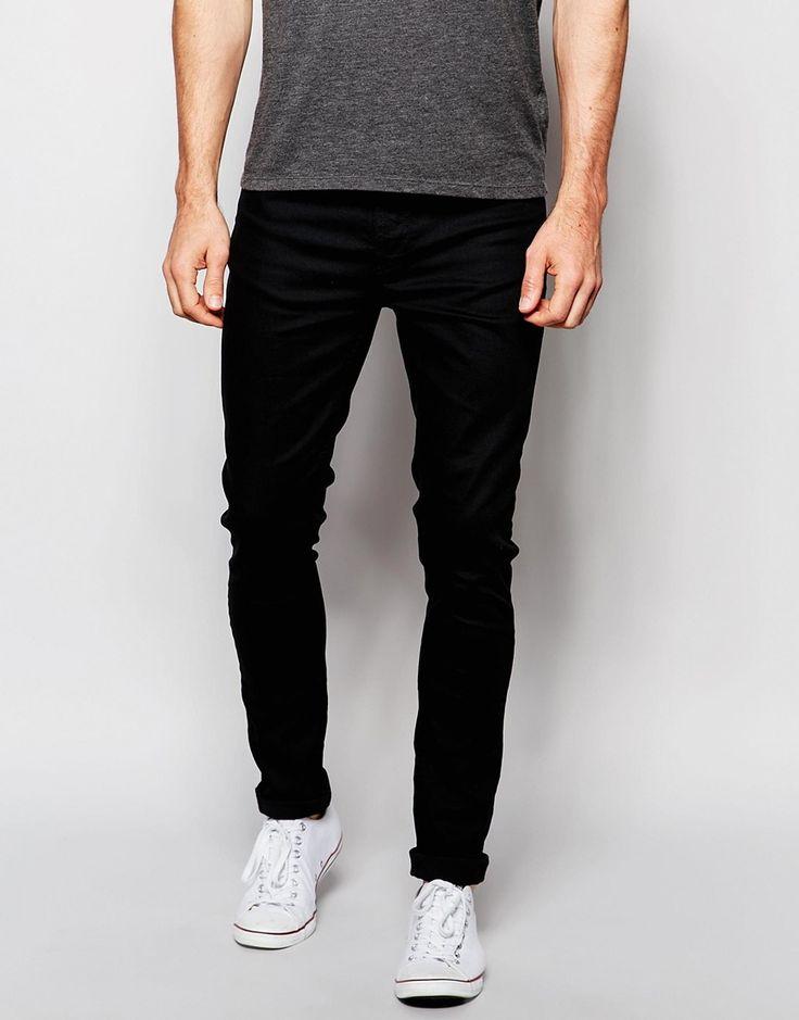 Superenge Jeans von Nudie Stretch-Denim dunkle Waschung verdeckter Reißverschluss fünf Taschen superenge Passform Maschinenwäsche 98% Baumwolle, 2% Elastan Model trägt 32 Zoll/81 cm Normalgröße und ist 188 cm/6 Fuß 2 Zoll groß