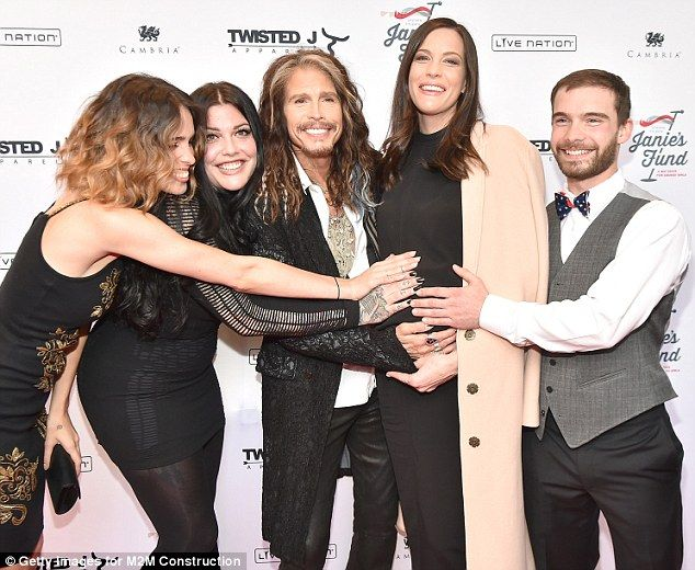 Hands-on family: Steven Tyler and his children posed with pregnant Liv at his Out On A Limb charity benefit in New York on Monday. (L-R) Chelsea, Mia, Liv and Taj.
