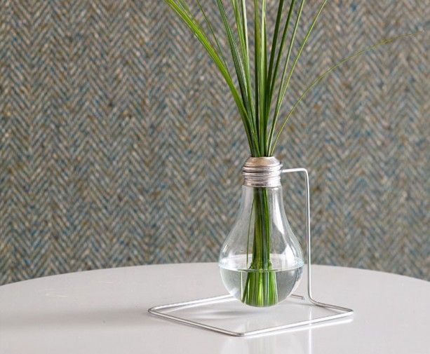 DIY: Lightbulb Bud Vase - As more efficient compact fluorescent lights save you money, you might have old or unused incandescent bulbs lying around. With a little effort and less than a dollar, you can put outdated bulbs to good use and have a miniature flower vase you'll be proud to show off. | #DIY #Vase |