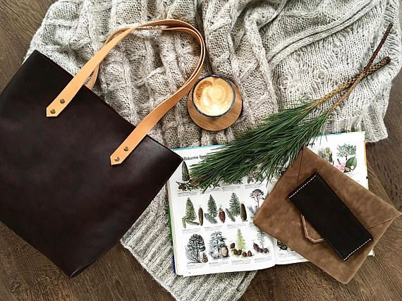 This large tote is made of gorgeous, German leather in a luxurious, dark mahogany brown. Natural veg tanned leather straps complete the look and will develop a beautiful patina with use.