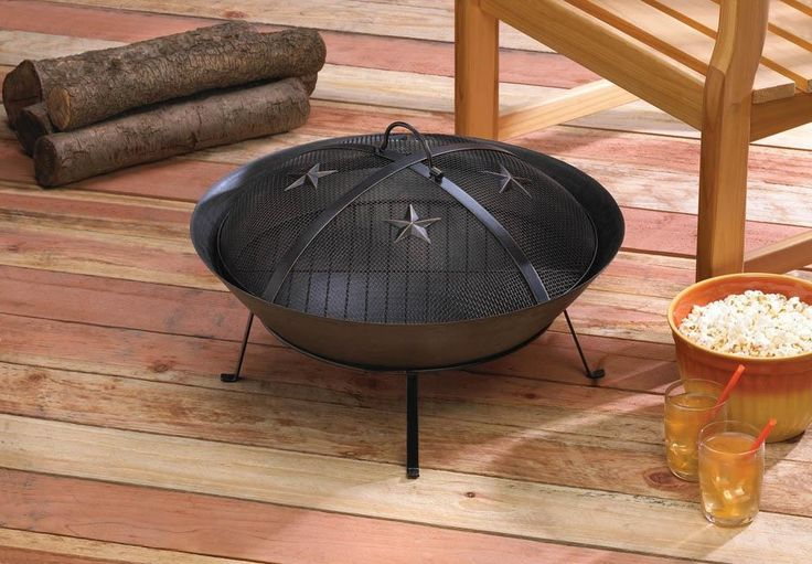 "WESTERN STARS FIRE PIT This Western-style more specifically Southwestern style fire pit will keep you warm as you enjoy a night under the stars whether your home is on the range or a little more suburban! It's design is quite simple and classic. The CAST IRON material promises long life even when exposed to the elements. The metal mesh lid features four stars and a Convenient handle for Easy removal. The base has four metal feet. Item weight: 9 lbs. Height 22"" x 22"" x 13""…"