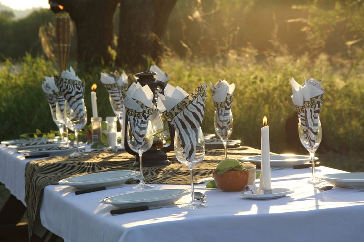 Romantic dinner in the bush in Karen Blixen style - with champagne and table set in White....
