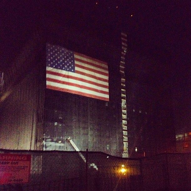 """""""Let's slap an Anerican flag up there. That way no one will notice our half-built building."""" #losangeles #california #why #flag #america #huh"""