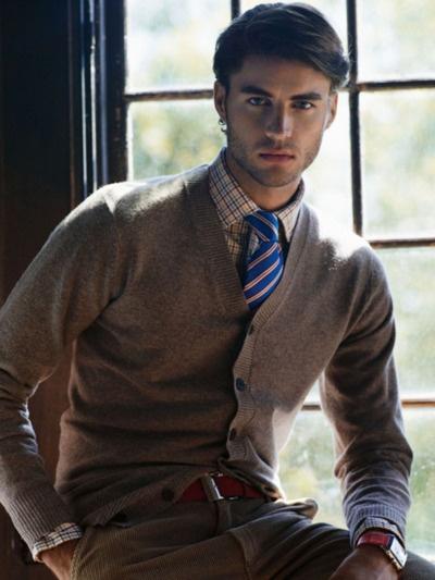 tan cardi, multicolored plaid shirt, blue striped tie, tan corduroys, brown belt..