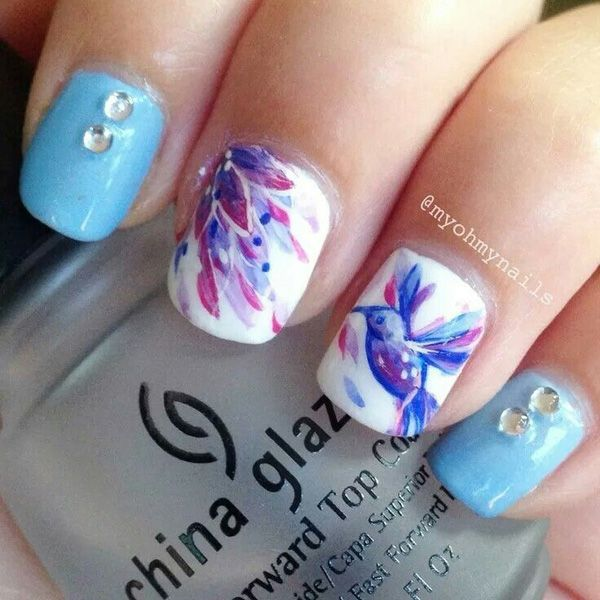 Get to draw washed out and watercolor inspired flowers on your nails. You can also push to be more artistic by adding a watercolor themed bird. Paint on with a sky blue polish and add beads for accent.