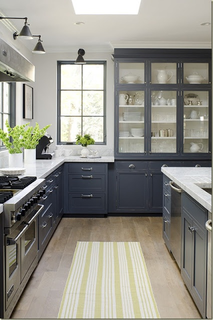 Classic kitchen layout by Maine designer, Jeanne Rapone. Interior Designer and homeowner, Bronwyn McCarthy Huffard, Huffard House Interiors. Inset cabinetry painted in a custom mixed charcoal grey (gray) which plays off thick marble counters. Built in breakfront china cabinet. The long glass front doors, exposed hinges and hardware are reminiscent of an earlier time. Love the steel framed windows.