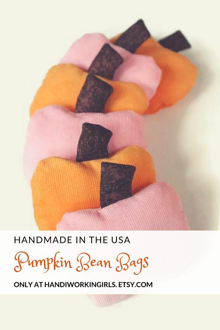 Blush pink and soft orange add a feminine twist to our pumpkin-shaped bean bags: https://www.etsy.com/handiworkingirls/listing/559367233/orange-and-pink-pumpkin-bean-bags-with