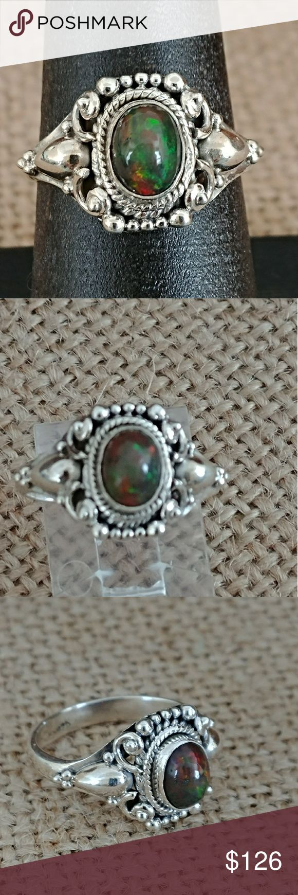 Australian Black Opal Ring Gorgeous natural Australian Black Opal set in a solid sterling silver traditional hand tooled ring. Black antiquing and scroll work make this a truly exotic ring. Size 7 Jewelry Rings