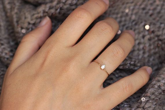 Dainty diamond engagement ring in 14k gold with a beautiful pear cut diamond. Clean, simple lines; gentle and feminine ring. Materials: 14k solid yellow