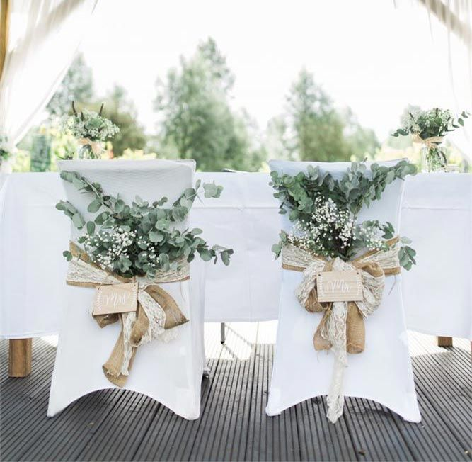 You can give chair covers a contemporary update with hessian, lace and foliage. Take inspiration from these stylish wedding chairs at West Street Vineyard – the Mr and Mrs wooden signs are a cute finishing touch.