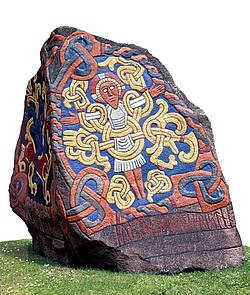 Reconstruction of Jelling Stone (Jellingestenen), Viking Ship Museum. On the Jelling Stone, it says that Harald Bluetooth Christianized the Danes, and the stone is perceived today as Denmark's birth certificate.