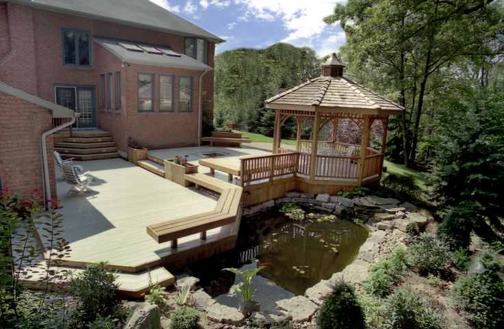 A large custom low maintenance deck built in the 1990's by Hickory Dickory Decks with a 13 foot gazebo.
