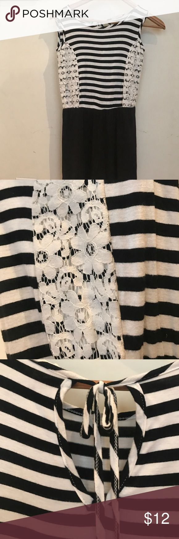 Black and White striped romper Sleeveless romper with black and white striped body, lace detail on side, tie closure on back, and black bottoms 😊 Btween Bottoms Jumpsuits & Rompers