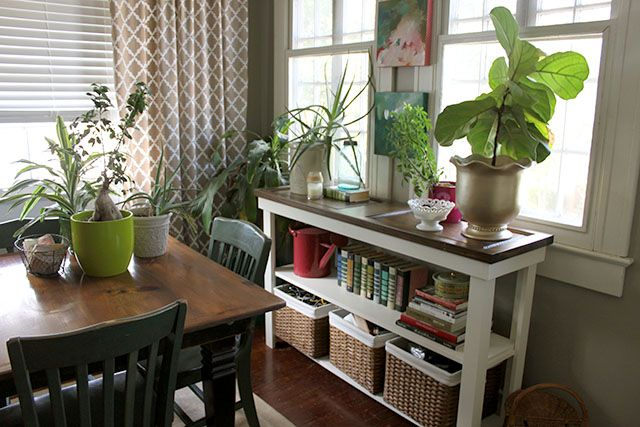 console table in dining room in front of window