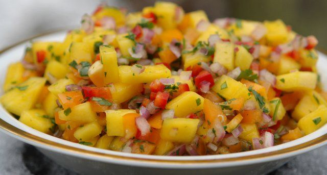 Delicious and colorful mango salsa recipe made with ripe mangoes, red onion, orange bell pepper, red Fresno chilies, cilantro, and lime