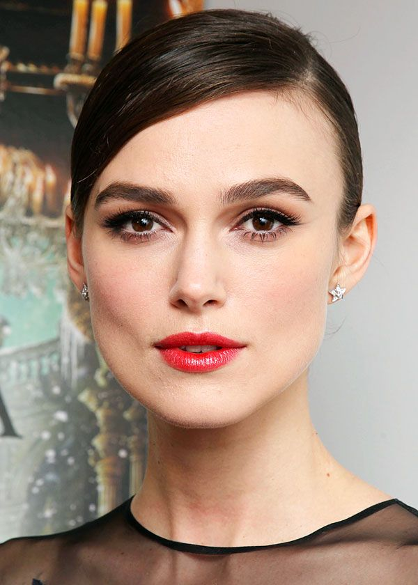 Keira Knightley…shiny light red lips, gorgeous eyes and slick hair