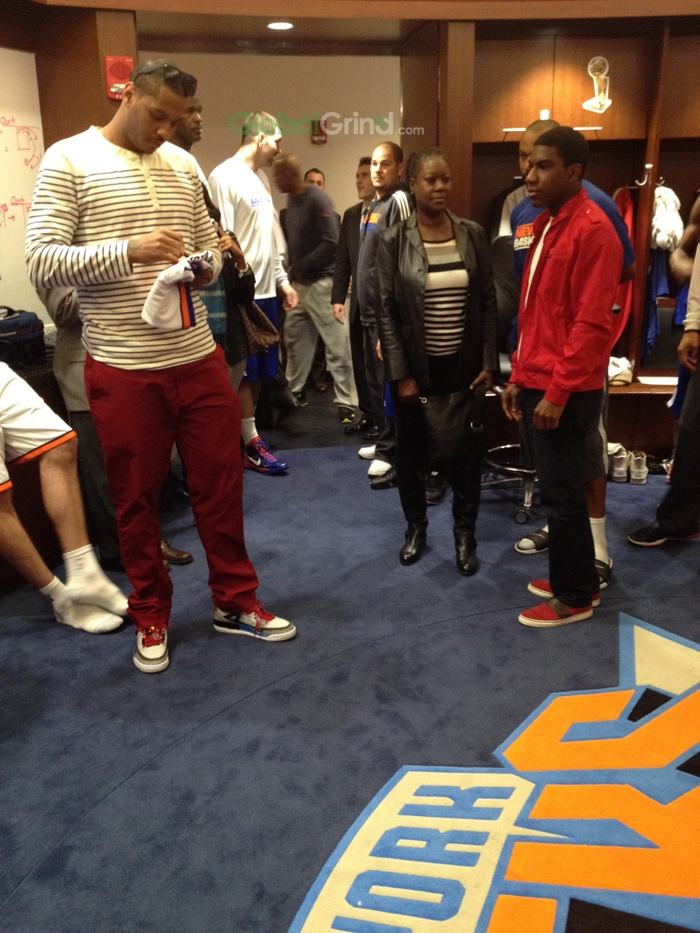 The Heartfelt Silence Of Carmelo Anthony - Anthony speaks with the family of Trayvon Martin before a game.