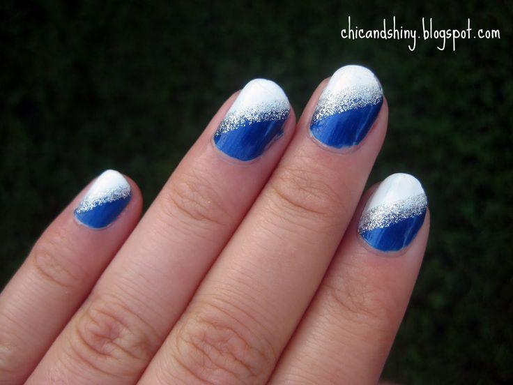 Nail art:    Blue and white nail art design