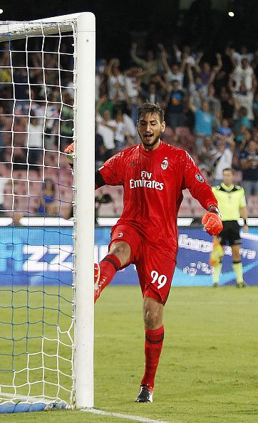 Milan's player Gianluigi Donnarumma stands disappointed during the Serie A…
