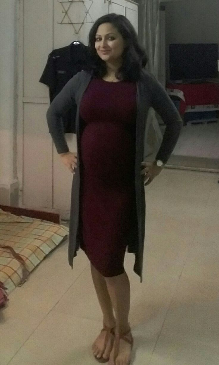 a simple bodycon dress for night out during that best time with cute lil baby bump
