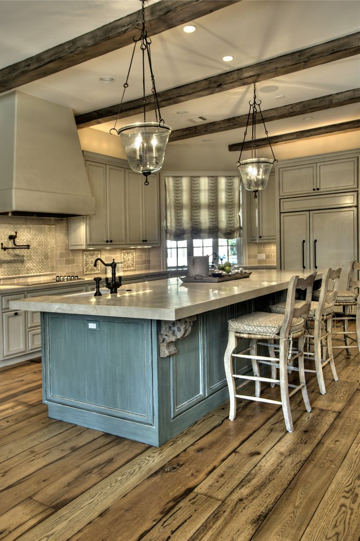 I think what I really love about this kitchen is floor...and the ceiling (the beams and the light fixtures!) And also the color of blue.