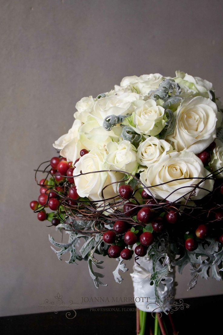 Winter frosted Bridal Bouquet, red berries, white roses, fine twigds and grey foliage, rustic wedding.