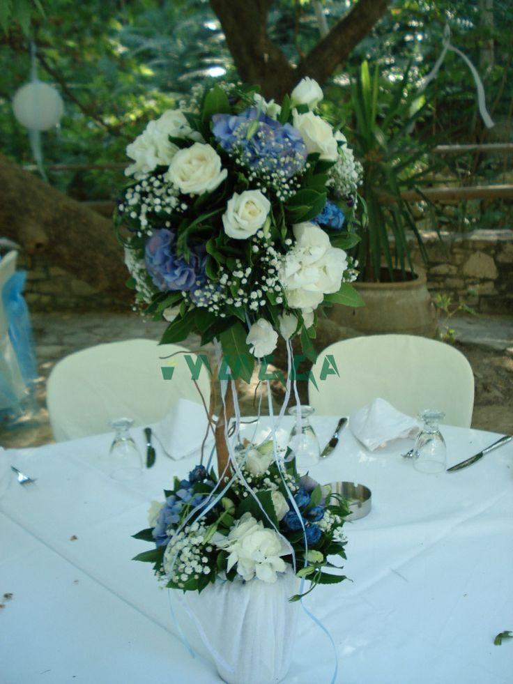 Flower tree with white and blue shades. #flowertree #centerpiece #tabledecor #weddingscrete #floristiraklion #whiteblue