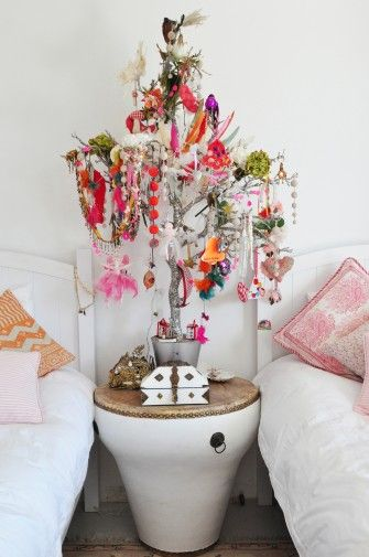 charming feather tree in girls bedroom.