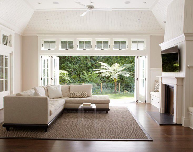 Transom windows over sliding folding glass patio doors
