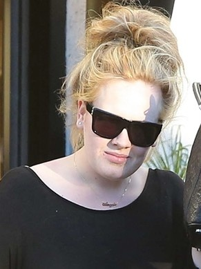 Adele wearing her son's name, Angelo, as a nameplate